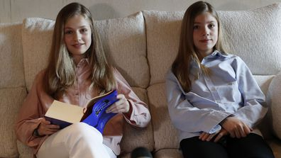 Princess Leonor of Spain (left) and Princess Sofia of Spain (right) read El Quijote book during the XXIV edition of continuous reading of El Quijote at Circulo de Bellas Artes on April 23, 2020 in Madrid, Spain