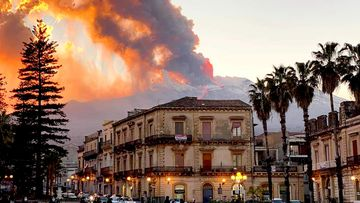 Mount Etna, Europe's most active volcano, spews ash and lava, as seen from Catania, southern Italy.
