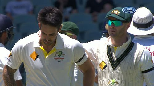 Mitchell Johnson is comforted by Michael Clarke. (9NEWS)