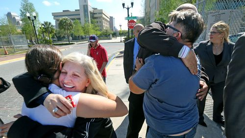 Family members of Noor Salman receive hugs from friends after a jury found Salman not guilty on all charges. (AP)