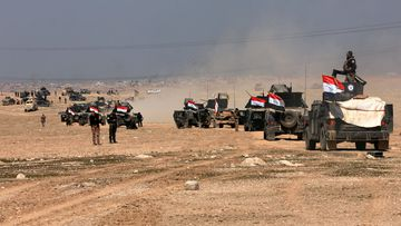 Iraqi special forces advance towards the western side of Mosul on Wednesday. (AAP)