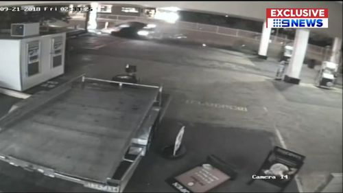 The crash on September 21 at a service station in Charlestown, Newcastle was caught on CCTV.