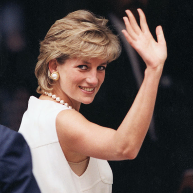Princess Diana waving to an enthusiatic crowd on the last day of her visit in Chicago in 1996.