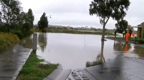 A Craigieburn street has been inundated after heavy rainfall. (9NEWS)