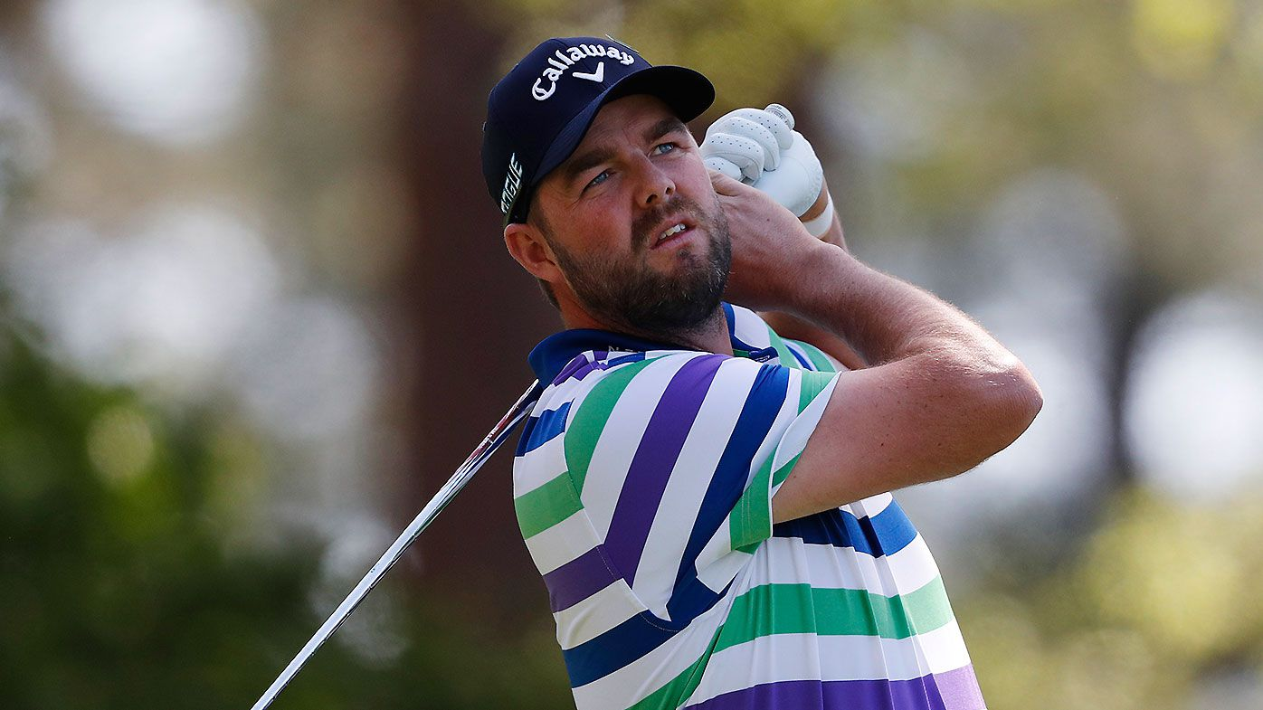 Marc Leishman of Australia hits his tee shot on the fourth hole