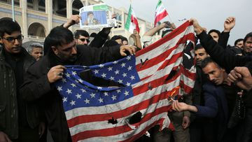 Iranians burn a US flag during an anti-US demonstration to condemn the killing of Iranian Revolutionary Guards Corps (IRGC) Lieutenant general and commander of the Quds Force Qasem Soleimani, after Friday prayers in Tehran, Iran