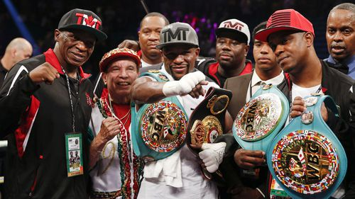 Floyd Mayweather wins 49th and final bout to finish controversial boxing career unbeaten