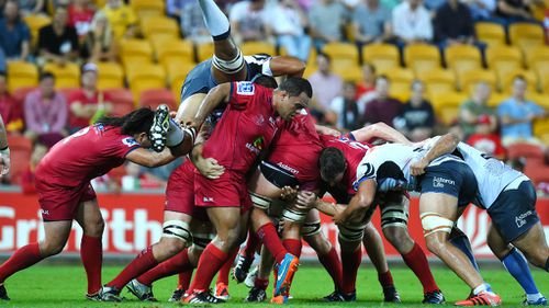 Under-siege Reds claim Super Rugby win after week from hell