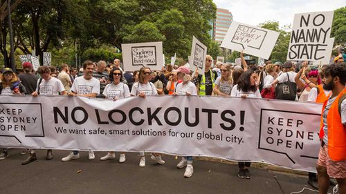 Demonstrators hold a banner saying No Lockouts! as thousands gather in Sydney's CBD on February 21, 2016 to protest against the New South Wales Government's lockout laws in the inner city during Keep Sydney Open rally. (AAP)