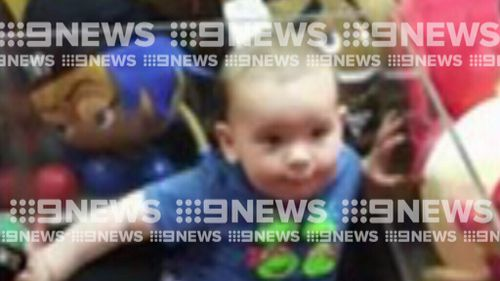 One-year-old Lewis climbed into an Adelaide skill-tester. (9NEWS)