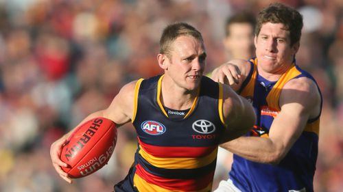 Crows defender Brent Reilly evades West Coast's Patrick McGinnity last year. (AAP)
