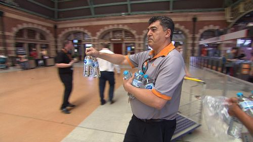 Transport staff spent the afternoon handing out complimentary bottles of water to commuters sweating it out on the train network.