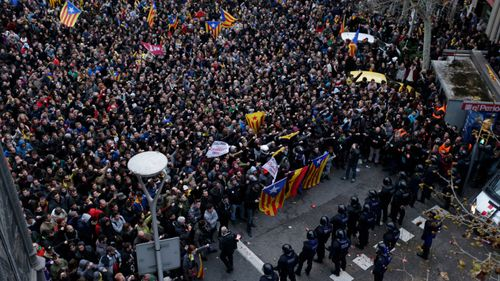 Protesters gather in central Barcelona. (AP).