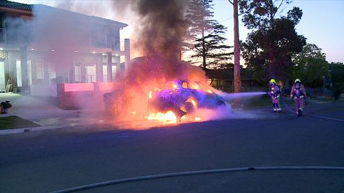 The car erupted into flames on Welsford St, Merrylands.