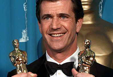 Mel Gibson with Oscars statuettes (AAP)