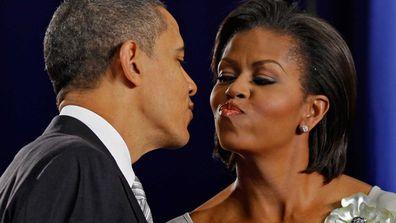 El Presidente enjoys a tight peck.