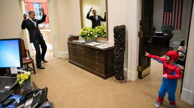 President Obama plays with the son of a White House staffer dressed as Spider-Man. (Flickr/White House)