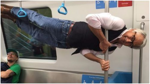 Groovy grandpa refuses 'elderly seat' on Rio train and performs impressive pole lift instead