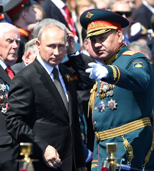 President of Russia and Commander-in-Chief of the Armed Forces Vladimir Putin and Russian Defense Minister Sergei Shoigu during a Victory Day military parade in Red Square