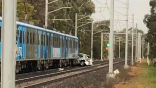 The vehicle became trapped under the train.