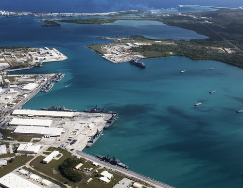 A handout file photo made available by the US Department of Defense showing an aerial view from above US Naval Base Guam and Apra Harbor. (AAP)