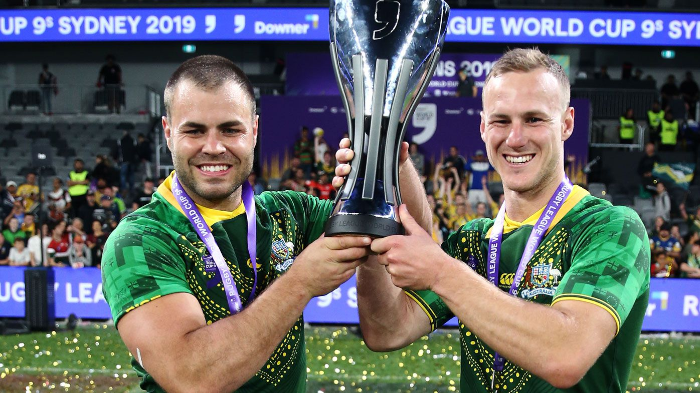 Wade Graham and Daly Cherry-Evans of Australia celebrate with the trophy after victory
