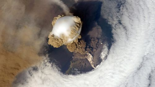Eruption of Sarychev Peak Volcano, Kuril Islands, north-eastern Japan on 12 June, 2009. The white matter on the side of the volcano is pyroplastic flow, as viewed from the International Space Station. (NASA)