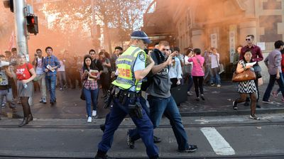 A protester is arrested as thousands of university students from the University of Sydney and UTS march through the city's CBD. (All images AAP)
