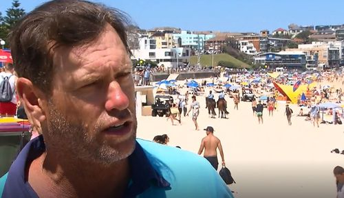 Lifeguards including Bruce Hopkins from Bondi Beach urged people to swim between the flags as the heatwave continues to build.