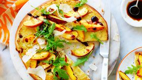 Yellow nectarine, artichoke and rocket pizza