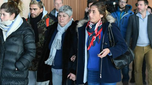 Emiliano Sala's mother Mercedes, centre left and sister Romina arrive back at Guernsey airport after taking a flight to view the area of the English Channel in which the missing footballers plane was last seen.