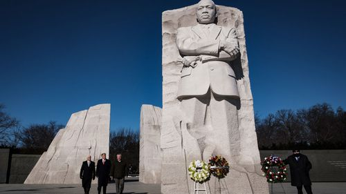 President Trump made an unannounced visit to the Martin Luther King Jr memorial in Washington on the national holiday honouring the civil right leader