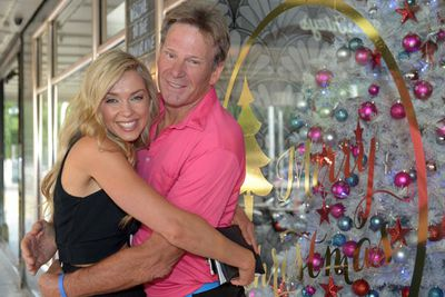 Sam Newman has Chrissie cuddles with <i>Postcards</i> presenter and model Brodie Harper.