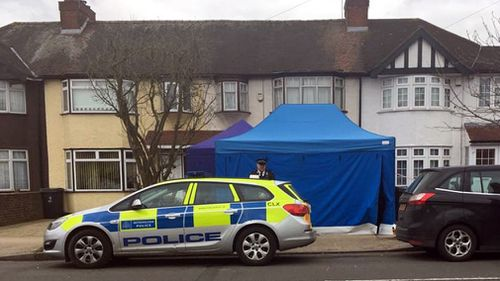 Police swarm the property in New Malden in London's south west. (PA/AAP)