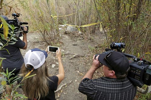 """Journalists view the spot where Mark Salling, who played Noah """"Puck"""" Puckerman in the hit musical-comedy """"Glee,"""" was found dead in a remote area of Big Tujunga Canyon in the Sunland-Tujunga area of Los Angeles. (AAP)"""
