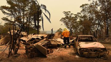 Adam Small from the RFS inspects some of the damage in Balmoral.