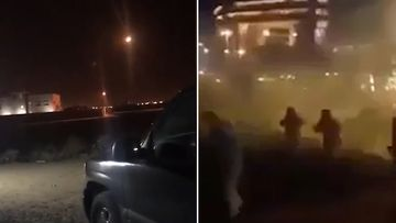 Video posted online shoes what appears to be an anti-missile battery firing and people racing away through clouds of smoke or dust. (Twitter)