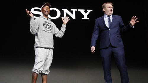 Chief Executive Officer Sony Music Entertainment Rob Stringer (R) speaks next to US rapper Pharrell Williams (R) during the 2019 International Consumer Electronics Show in Las Vegas.
