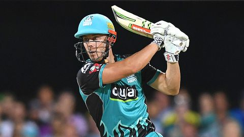 Chris Lynn of the Heat hits a boundary