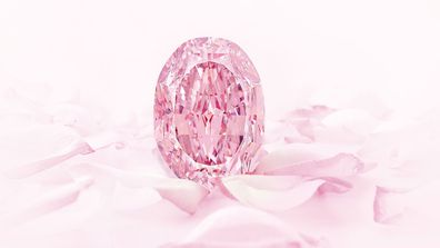 """The 14.83-carat stone, dubbed """"The Spirit of the Rose,"""" is now the most expensive purple-pink diamond ever to sell at auction, according to Sotheby's"""