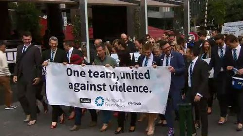 Staff in Melbourne marched along Southbank before ending up at Federation Square. (9NEWS)