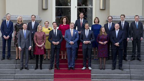 Prime Minister Mark Rute, centre left, and Dutch King Willem-Alexander, centre, pose with the ministers for the official photo of the new Dutch government on the steps of Royal Palace Noordeinde in The Hague, Netherlands (Photo: October 2017)