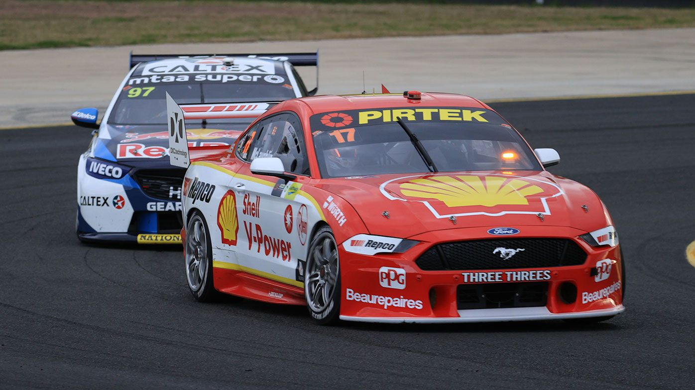 Scott McLaughlin held off Shane van Gisbergen at Sydney Motorsport Park.