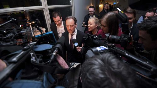 Greg Hunt speaks to the media.