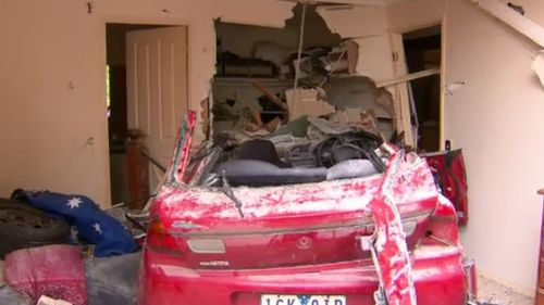The red Mazda smashed into The Promenade home about 7.20am. (9NEWS)