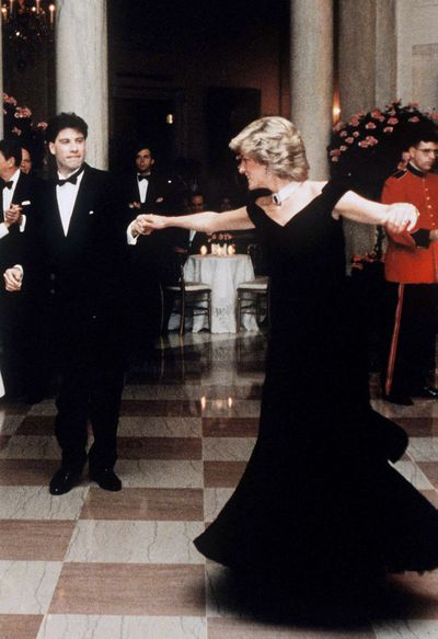 Dancing with John Travolta at the White House during her visit to America in 1985.