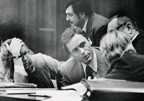 Theodore Bundy confers with his defence attorneys on the opening day of his murder trial.