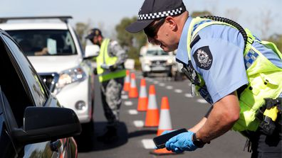 Police stopping drivers at checkpoints