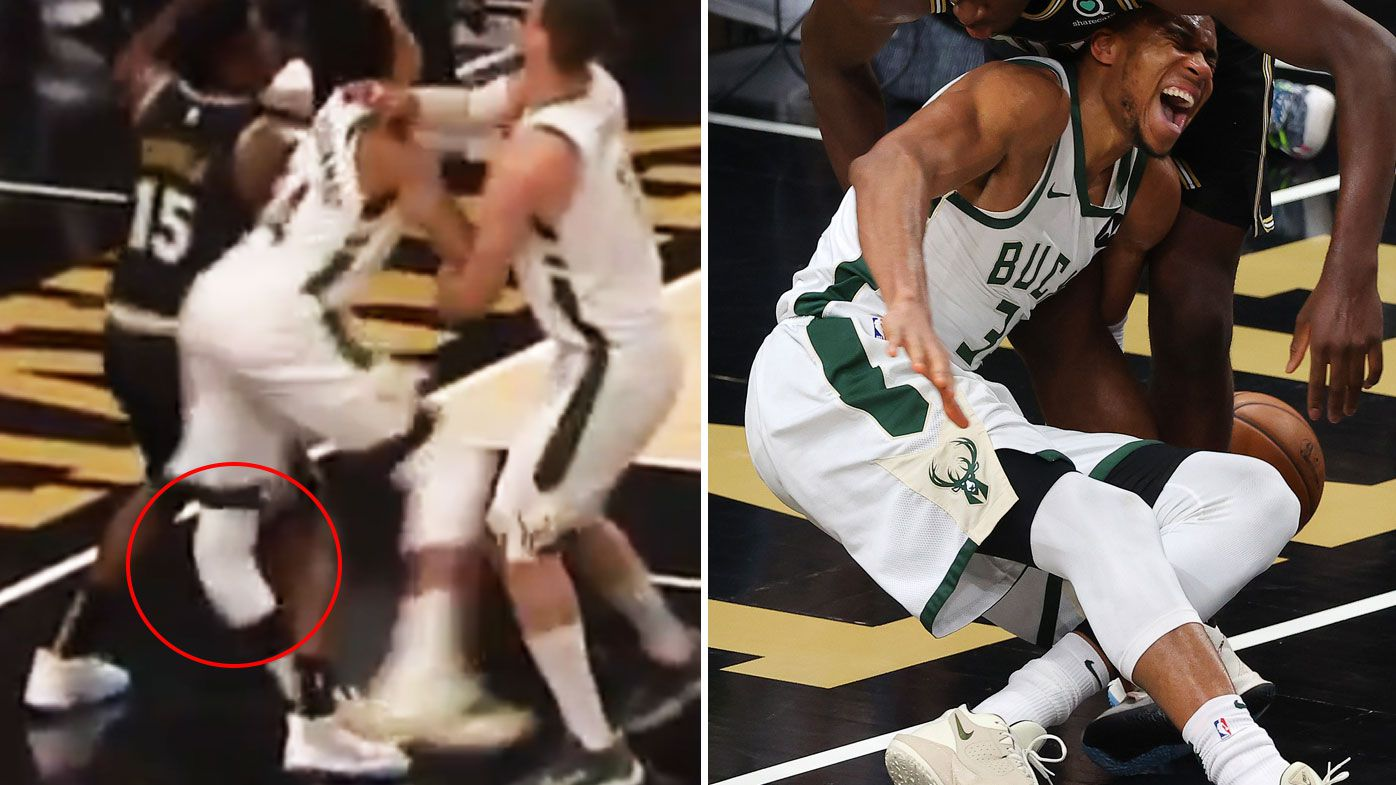 Giannis Antetokounmpo goes down with a horror knee injury against the Hawks in Game 4.