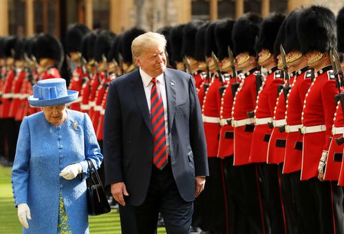 Trump and Britain's Queen Elizabeth II inspect a Guard of Honour, formed of the Coldstream Guards at Windsor Castle in Windsor, England.